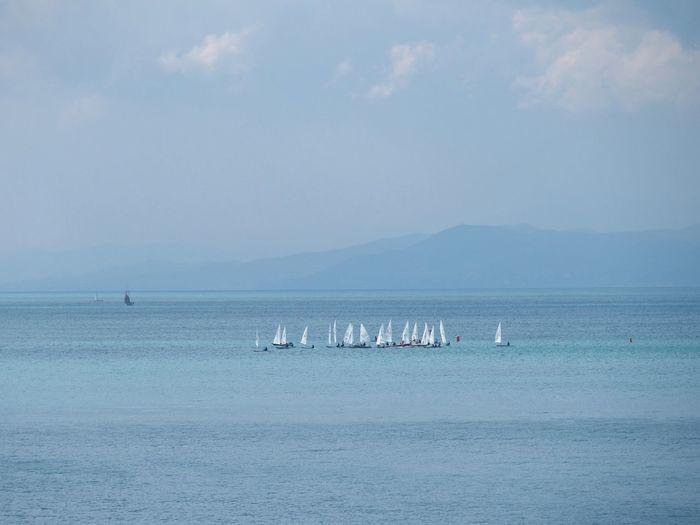 Boats Sailing At Sea Against Sky
