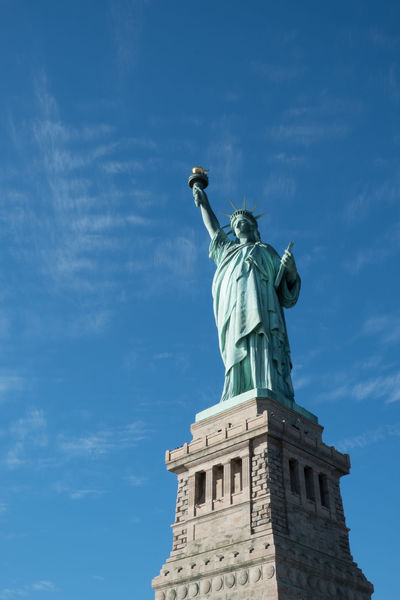 Lady Liberty by Bartholdi based on the Colossus of Rhodes, isolated with no buildings in the background. Statue of Liberty on her pedestal with beautiful blue skies and a few wispy clouds. Ellis Island  Ellis Island / Statue Of Liberty Liberty Island Liberty Island Ferry New York New York City New York ❤ New York, New York Outdoors Sky Statue Statue Of Liberty Statue Of Liberty New York Travel Destinations