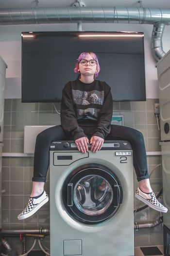 copenhagen Green Laundry Room Laundry One Person Indoors  Looking At Camera Sitting Portrait Casual Clothing Adult Front View Real People Mid Adult Glasses Women Lifestyles