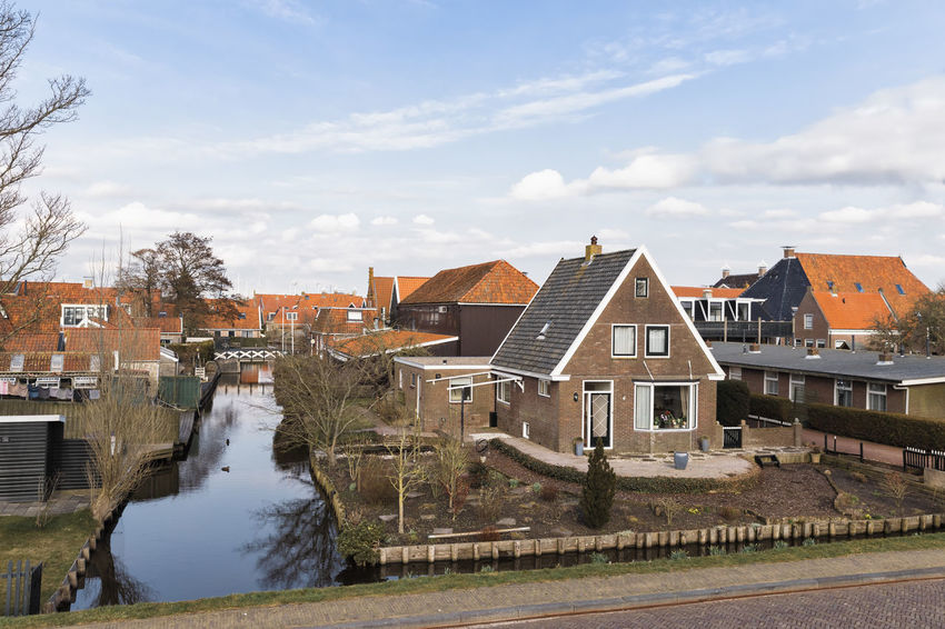 Residential buildings and canal in Hindeloopen, Netherlands, Europe Cityscape Elfstedentocht Hindeloopen Netherlands Old Town TOWNSCAPE Tradition Arch Building Exterior Canal Cottage Friesland Front Or Back Yard High Angle View History House No People Residential Building Residential District Residential Structure Town Town Canal Village Water Waterfront