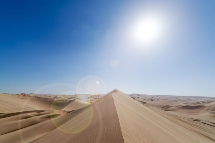 Sand dune landscape with lens flare at Huacachina, Peru America Beautiful Buggy Desert Dry Dune Dunes Huacachina Ica Landscape Nature Oasis Outdoor Peru Sand Sandboard Sandy Sky South Summer Sun Tourism Travel Vacation Warm