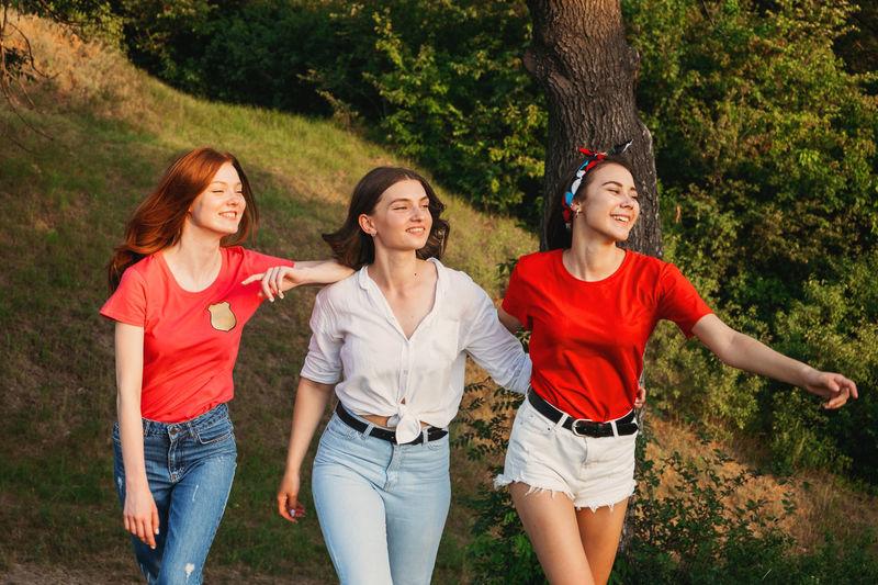 Gen z, friendship, togetherness. three happy girl friends, teenage girls enjoing their tim