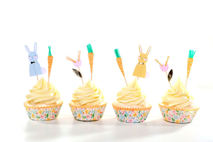 Close-up of cupcakes against white background