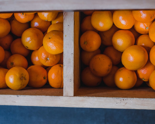 Food Healthy Eating Food And Drink Wellbeing Freshness Fruit Orange Color Wood - Material Citrus Fruit Orange Orange - Fruit No People Large Group Of Objects Day Still Life Close-up High Angle View Crate Abundance Box Outdoors Ripe