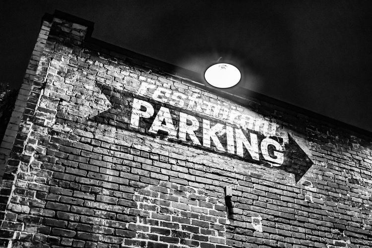 favourite columbia places at night Text Architecture Communication Low Angle View Built Structure Wall - Building Feature Brick Wall No People Brick Illuminated Capital Letter Lighting Equipment Sign Outdoors Guidance Parking Blackandwhite