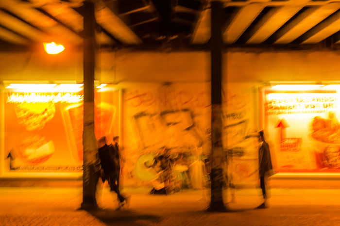 abstract people under the bridge with music in the city Architecture Berlin City Cityscape Encounter Music Sidewalk Abstract Art Blur Blurry Bridge Busker Deformed Disfigured Dynamic Evening Light And Shadow Long Time Exposure Nighlife Night People Scenics Streetphotography Town
