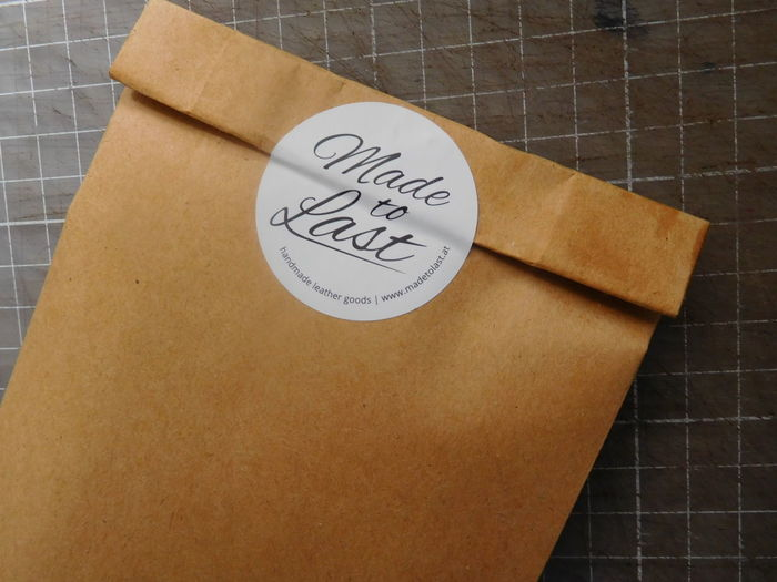 High angle view of text on brown paper envelope