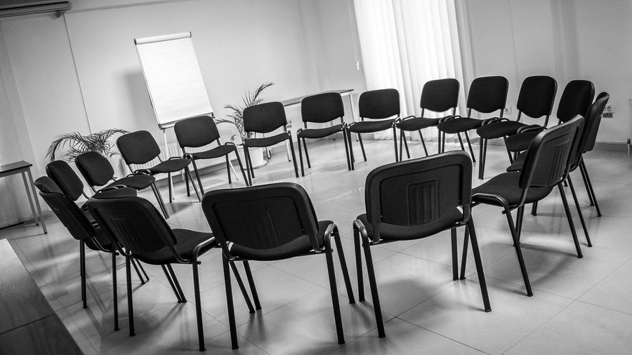 Empty chairs arranged in classroom