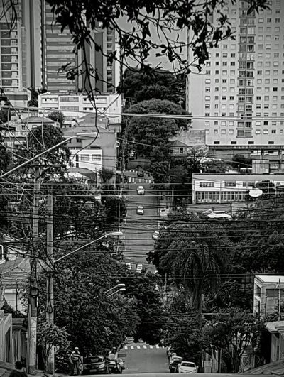 Downhill Uphill City Urban Cables And Wires Man Walking Up Sloping Street Slope Sloping Road Street