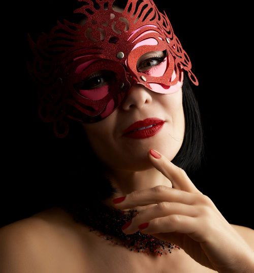 Close-up portrait of woman wearing mask