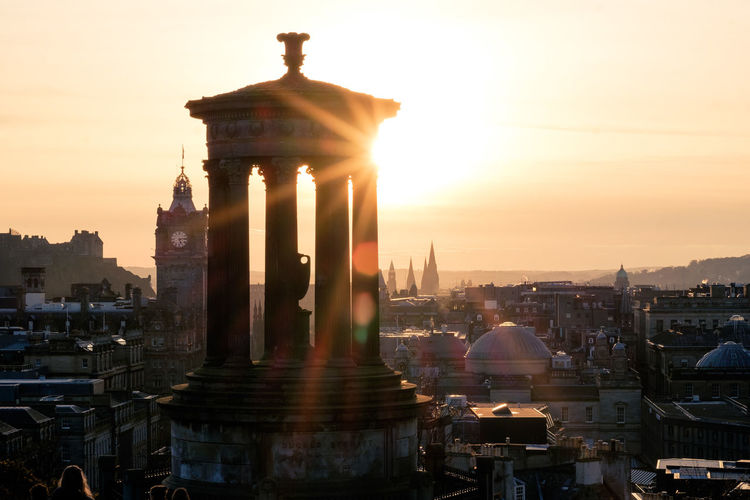 Sunset atop Calton Hill overlooking Edinburgh old town Architecture Edinburgh Flare Fujifilm X-E2 Fujinon56mm1.2 Sun Star Sunset Tourism Travel Travel Photography First Eyeem Photo