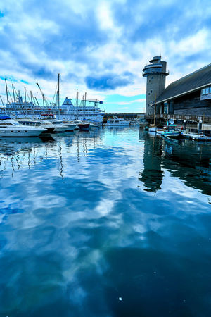 Reflections of boats, masts and clouds in the sea at Falmouth, Cornwall, K Architecture Beauty In Nature Building Exterior Built Structure Cloud - Sky Day Harbor Mode Of Transport Nature Nautical Vessel No People Outdoors Reflection Sea Sky Transportation Water Waterfront