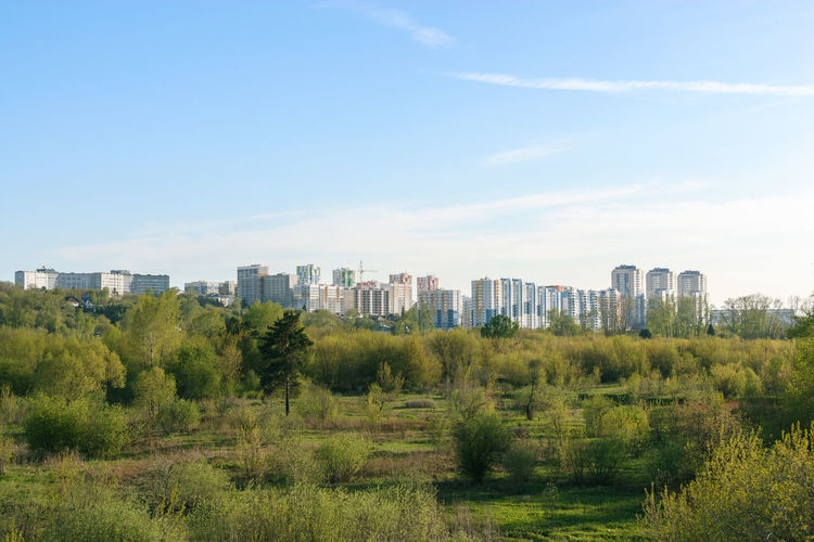 Skyline Architecture Building Exterior City Cityscape Cloud - Sky Day Grass Green Color Growth Landscape Nature No People Outdoors Sky Tree Urban Skyline