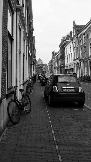 Photo courtesy of my son David Raphael. Used with permission. Edits mine. Mine Architecture No People Street Street Life Street Photography Streetphotography Streetphotography_bw Mobilephotography Blackandwhite Black And White Monochrome Photography Monochrome Architecture City Street Eyeem Philippines Perspectives Photowalking Leiden EyeEm Leiden