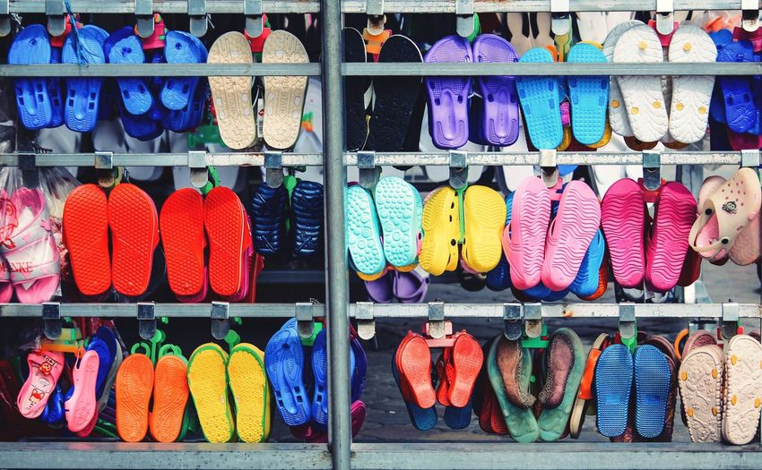 Full frame shot of footwear on rack at market stall