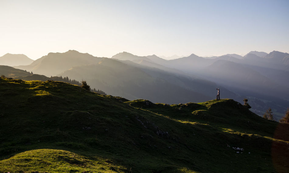 Beauty In Nature Distant Early EyeEm Best Shots EyeEm Best Shots - Landscape EyeEm Nature Lover Figure Hill Landscape Light Morning Mountain Mountain Peak Mountain Range Mountains Nature Outdoors People Remote Sky Sunrays Travel