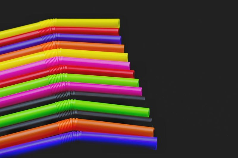 High angle view of multi colored pencils against black background