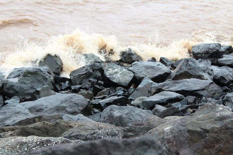Forces Water Force Wave Power In Nature Sea Crash Beach Motion Sand Shore Pebble Beach Rocky Coastline Crashing Boulder Stack Rock