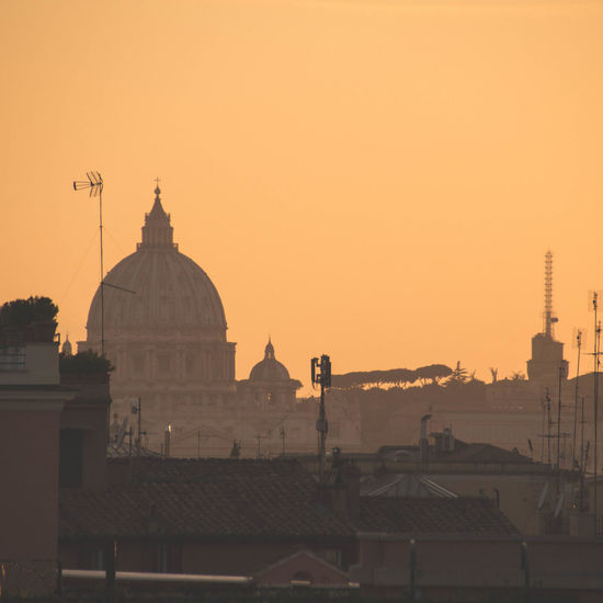 St peter basilica against clear sky during sunset