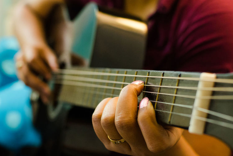 Arts Culture And Entertainment Close-up Depth Of Field Detail Guitar Guitarist Heart Shape Hobbies Holding Human Hand Indoors  Music Musical Instrument Occupation Part Of Preparation  Selective Focus Single Object Still Life Studio Shot Table