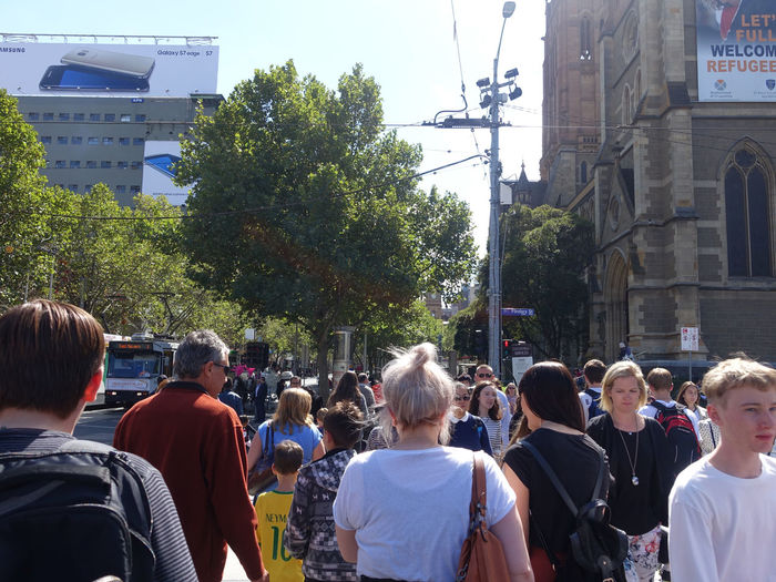 A street scene in Melbourne, Australia. Crowd Group Of People Architecture City Men Building Exterior Built Structure Large Group Of People Real People Street Building Day Rear View Plant Lifestyles Tree Nature Walking Transportation Traffice Melbourne City Busy Street