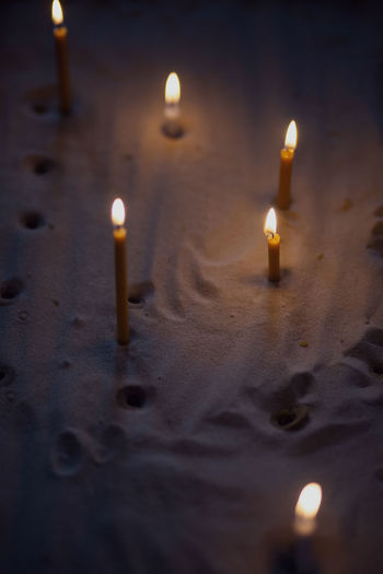 High angle view of lit candles