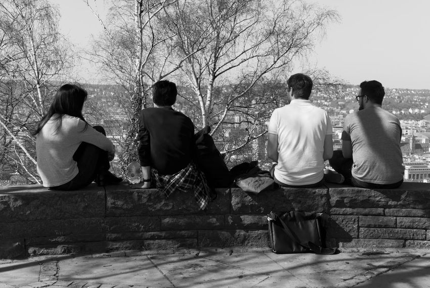 The government Adult Blackandwhite Casual Clothing Couple - Relationship Day Friendship Full Length Group Of People Leisure Activity Lifestyles Men Monochrome Nature Outdoors People Real People Rear View Sitting Togetherness Tree Women