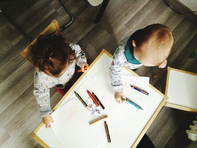 Toddler  Toddlerlife Toddlers  Childhood Children Children Only Children Playing Exploring Growing Up Working Occupation Teamwork Business Artist High Angle View Design Professional Business Finance And Industry Sketch Paper Creative Occupation Drawing - Art Product Drawing - Activity Modern Workplace Culture
