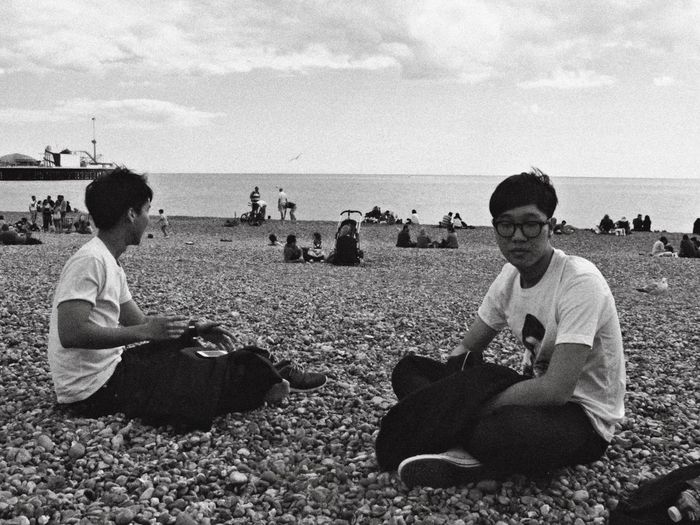 Sea Horizon Over Water Sitting Beach Sky Relaxation Men Full Length Technology Outdoors Real People Nature Adult Day Young Adult People Adults Only England Brighton Travel Backpacking Lifestyles Adventure Travel Destinations Enjoy The New Normal