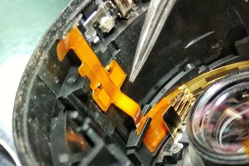 repairing the lens Circuit Inside Dirty Optic Lens Repairs Maintainance Service Close-up Technology No People Indoors  Day