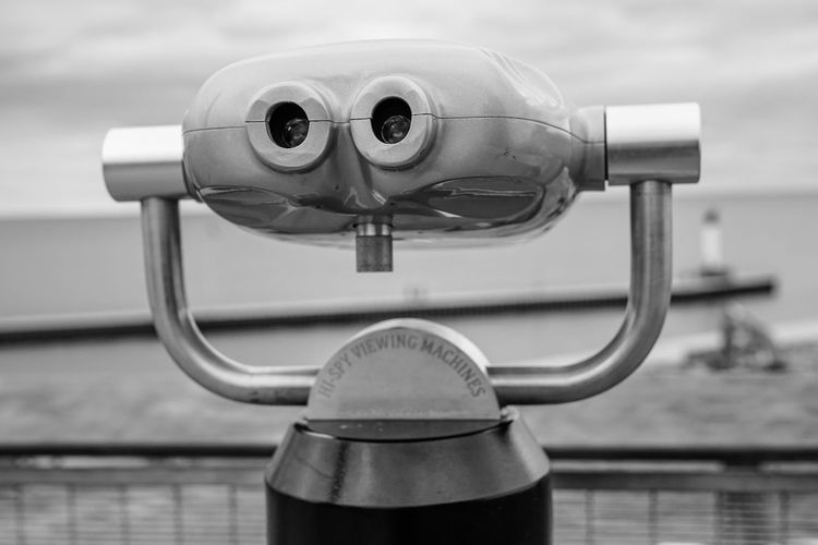 harbour look out Blackandwhite Monochrome Lighthouse Lake Water Pier Viewing Platform Zoom Focus Scene Coin-operated Binoculars Water Gauge Metal Silver Colored Binoculars Close-up Sky Coin Operated Telescope Optical Instrument Observation Point