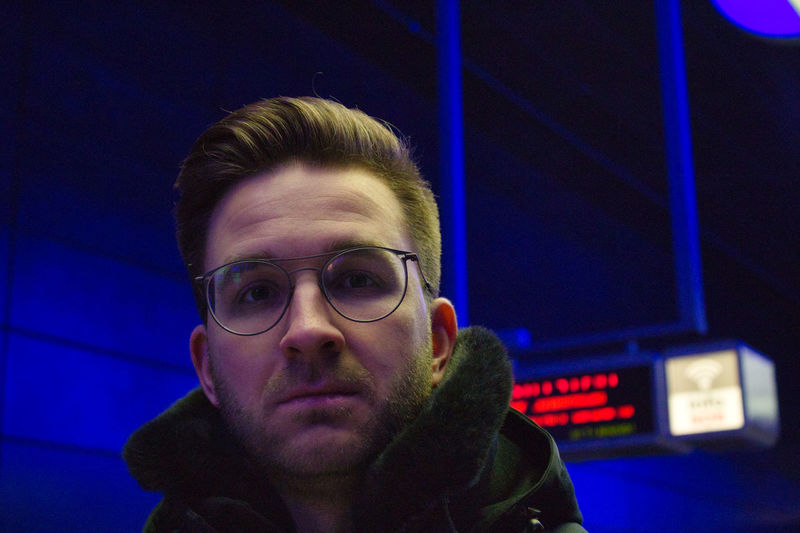 Portrait Headshot One Person Front View Looking At Camera Real People Young Adult Young Men Leisure Activity Lifestyles Men Illuminated Males  Mid Adult Men Eyeglasses  Indoors  Blue Night Underground Underground Station  Streetphotography