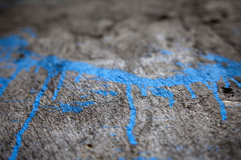 Blue paint on textured surface