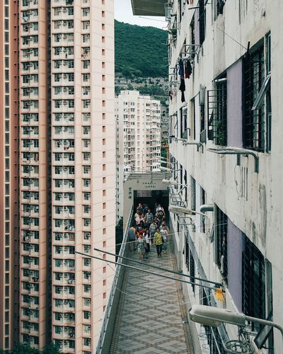 Estate life on the hills. Architecture Building Exterior Skyscraper People Real People Day Discoverhongkong Urbanphotography Chasinglight Cityscape Hong Kong HongKong Maximalist Residensity Housing Estate Street Photography Streetphotography Cityscapes Street Maximalist