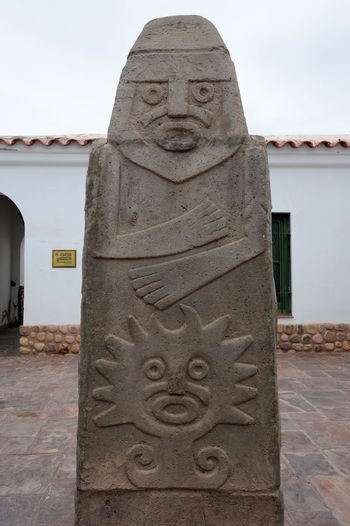 Archeological Site Architecture Argentina Art And Craft Building Exterior Built Structure Carving - Craft Product Close-up Day History Human Representation Jujuy No People Outdoors Place Of Worship Pucara Religion Sculpture Sky Spirituality Statue Stone Material Tilcara