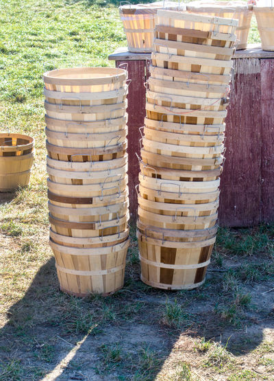 stack of bushel baskets are ready to be filled with fresh picked Michigan apples Day Container Nature Stack Wood - Material No People Sunlight Field Food And Drink Land Plant Outdoors Grass Close-up Cylinder In A Row Basket Large Group Of Objects Bushel Baskets Picking Apples Orchard Vertical Farming Fruit Farm Michigan, USA