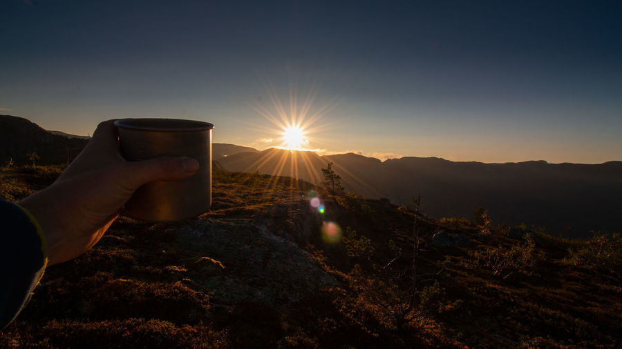 amazing sunrise after a cold night in telemark, norway Beautiful Exploring Adventure Body Part Finger Hand Holding Human Body Part Human Hand Leisure Activity Lens Flare Lifestyles Mountain Nature One Person Outdoors Personal Perspective Real People Sky Sun Sunbeam Sunlight Sunrise Sunset Unrecognizable Person