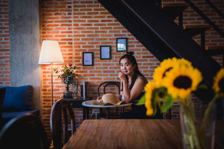Woman sitting on table