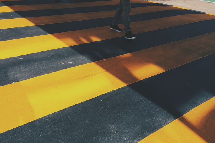 Zebra Crossing Caution Street Forword Foot Sign LINE Yellow Traffic Symbol Shadow People Black Sneaker Walk Jeans Safety Design City Road Hazard Highlight Contrast Stepping EyeEmNewHere