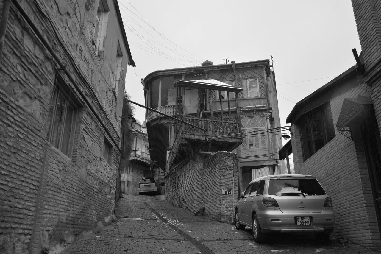 VIEW OF ALLEY AMIDST BUILDINGS