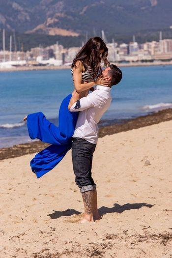 Full length of happy girl standing on beach