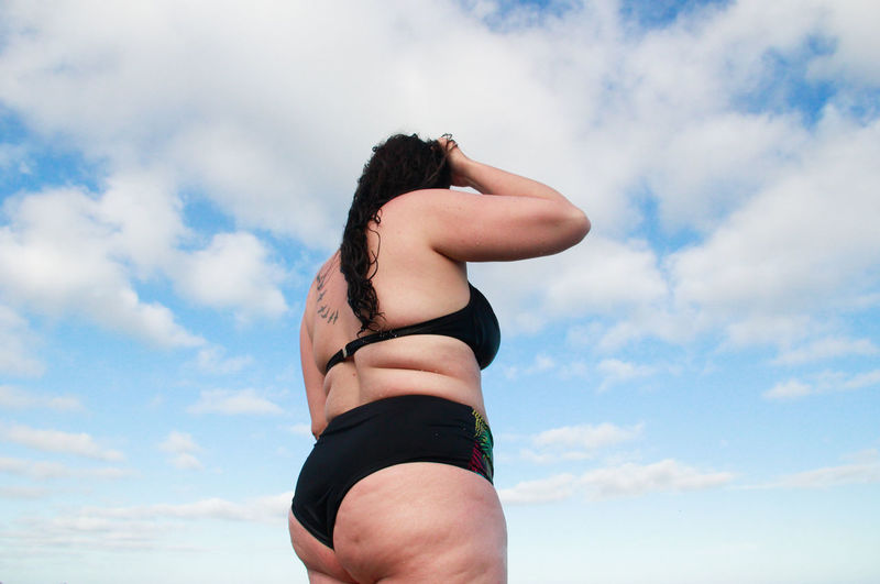Low angle view of woman against sky