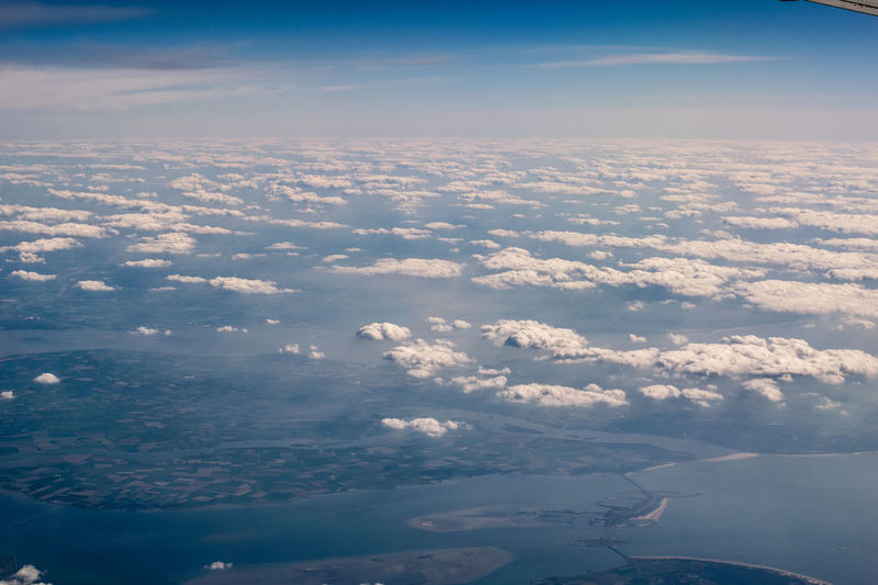 View From A Plane Aerial View Airplane Airplane Wing Beauty In Nature Cloud - Sky Day Flying From A Plane Window From An Airplane Window Holland Nature No People Outdoors Plane Window Scenics Sea Sky Tranquil Scene Tranquility View Into Land Water