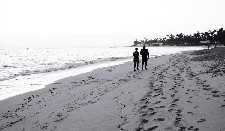 beach walking Love Quiet Beach Sand Sea Horizon Over Water Summer Full Length Togetherness Landscape Silhouette Vacations Sky Nature Adult People Outdoors Day Water Bonding Sand Dune Beauty In Nature