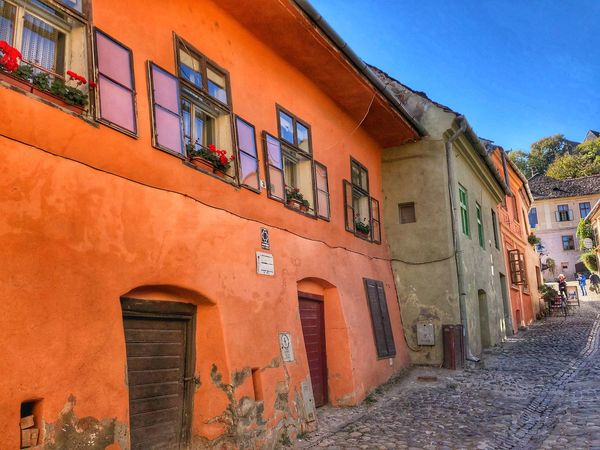 Medieval towns Sighisoara-Romania Street Photography Eye Em Around The World Colorful Houses Facades EyeEm Best Shots EyeEm Gallery Quaint Places Medieval Town Eastern Europe Doorsandwindows Historical Building Architecture Building Exterior Built Structure Window Building Residential District Sky No People Day Outdoors Wall - Building Feature Low Angle View House Old Street