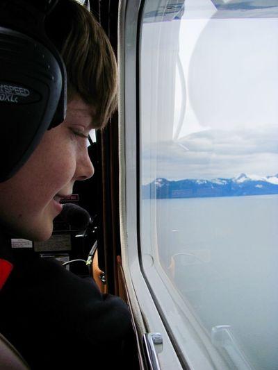 Connor on floatplane Adventure Aerial View Boy Floatplane Headset Looking Out Of The Window Ocean Travel Window