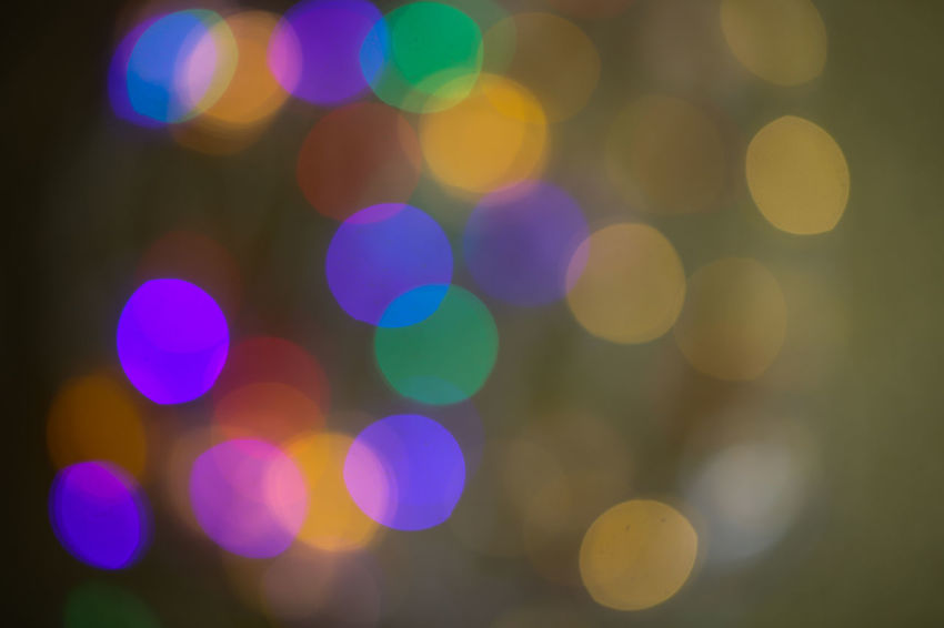 Abstract Backgrounds Blurred Motion Circle Defocused Disco Lights Electric Light Geometric Shape Glowing Illuminated Lens Flare Light Light - Natural Phenomenon Light Effect Lighting Equipment Motion Multi Colored Night No People Outdoors Pattern Purple Shape