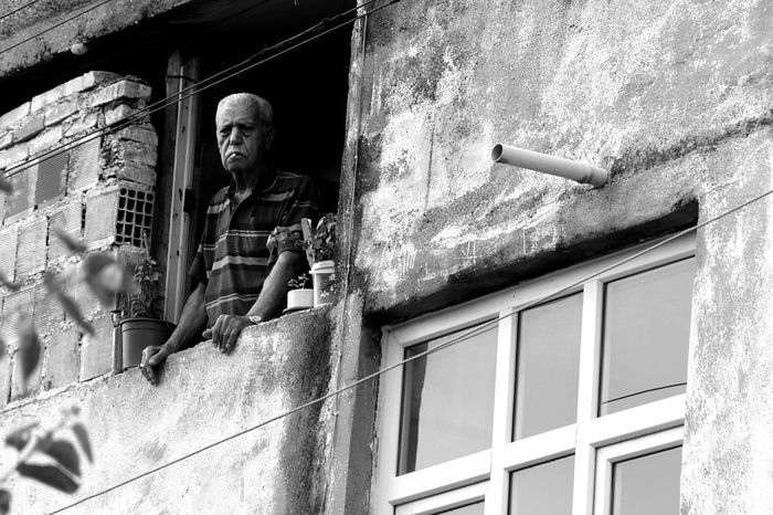 Senior Adult House Window Senior Women Building Exterior Low Angle View Built Structure Adult Architecture People Full Length Adults Only Outdoors One Person Day One Man Only Only Men The Street Photographer - 2017 EyeEm Awards The Portraitist - 2017 EyeEm Awards
