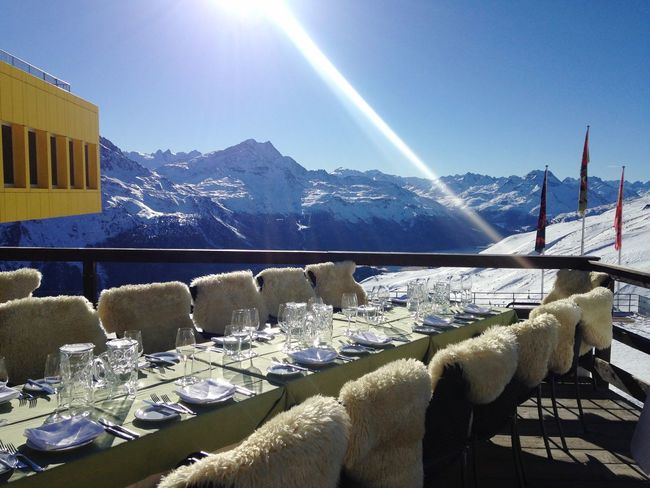 A perfect spot for lunch.. 🍴🌞🗻💛 Mountain Sunlight Snow Winter Mountain Range Sky No People Built Structure Chair Scenics Day Outdoors Table Design Architecture Ski Resort  St Moritz Switzerland January Restaurant Corviglia Ski Holiday Places To See Places To Eat Breathtaking