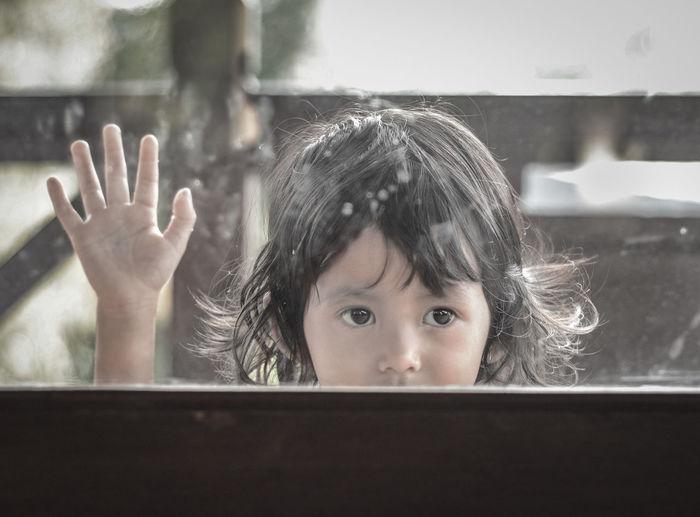Close-Up Of Girl Seen Through Glass Window